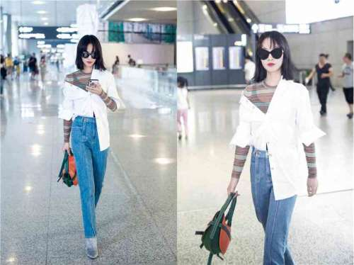 蓝盈莹白衬衫牛仔裤现身机场长腿身材堪比超模